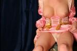 Free porn pics of Delia TS in pink pirate robe masturbating 1 of 7 pics