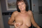Free porn pics of Joëlle holding here naturel mature tits in here hand 1 of 15 pics
