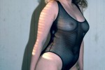 Free porn pics of Cheri stripping a body suit 1 of 32 pics