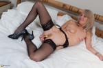 Free porn pics of Nice mature blonde stripping and toying 1 of 16 pics