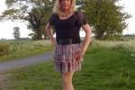 Free porn pics of CD Nicola in Black Top & Short Floral Skirt 1 of 16 pics